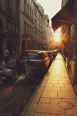 Paris street at sunset (nina's clicks) Tags: street sunset sun man paris car awning atardecer calle flare hff