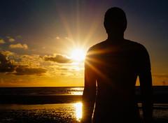 Sunset, Crosby Beach, Liverpool (Bev Goodwin) Tags: sunset england water silhouette liverpool crosby antonygormley merseyside anotherplace ironmen sonya37