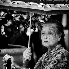 le stagioni della vita #2 (* onda *) Tags: bw woman umbrella gaze macao 500x500