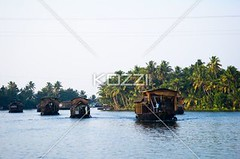 Boating on the River (frannature8877) Tags: poverty travel cruise blue trees plants cloud india tree tourism water ferry rural river palms asian boats outdoors canal outdoor indian side poor vessel bluesky kerala case palm clean adventure clear laundry palmtree transportation tropical vegetation tropic indians botany tropics chores clearsky southindia freshwater environments noclouds canalboats traveldestinations boattravel tropicalclimate keralastate atmosphereandsky indianethnicity boattransportation bluelightsky