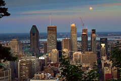 Moon over Montreal (Bokeh & Travel) Tags: sunset summer canada colors beautiful skyline architecture landscape colorful cityscape skyscrapers quebec montreal sunsetlight sunsetcolors blueevening