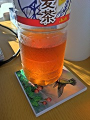 Glowing Barley Tea (sjrankin) Tags: 24july2016 edited hdr yubari hokkaido japan tea bottle light mugicha barleytea table sunlight