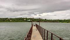 Over the Lake (views@vista) Tags: boating clouds hills lake maharashtra monsoon pune rains sky water