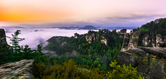 Bastei Panorama (redfurwolf) Tags: morning bridge sky panorama cloud mountain tree nature sunrise germany landscape deutschland rocks pano saxony sachsen bastei schsischeschweiz saxonswitzerland sonyalpha redfurwolf