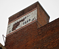 Sign Remnant, Peoria, IL (Robby Virus) Tags: peoria illinois sign signage remnant faded cracked building top