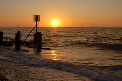 A beach view of the risen sun (Kirkleyjohn) Tags: suffolk sunrise light beach lowestoft lowestoftsouthbeach lowestoftbeach groyne silhouette sun