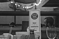 West End Roof-Top Deck Setting (brucetopher) Tags: table setting beer wine menu glass people light lighting lights tavern bar pub black white blackandwhite bw blackwhite monochrome card drink drinks