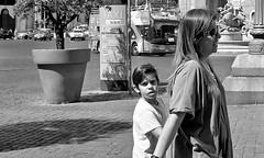 Curious. (Baz 120) Tags: candid candidstreet candidportrait city candidface candidphotography contrast street streetphoto streetcandid streetphotography streetphotograph streetportrait monochrome monotone mono blackandwhite bw urban noiretblanc life leicam8 leica primelens portrait people italy italia voightlander21mm grittystreetphotography decisivemoment strangers rome roma romepeople romecandid romestreets voigtlandercolorskopar21mmf40