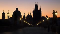 as the dawn burns away (cherryspicks (intermittently on/off)) Tags: prague czech urban skyline city sunrise towers roofs spires red gold landmark street lamp light church bridge art