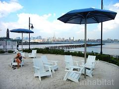 Newport Green is a Hidden Beach Tucked Along the Hudson River (Inhabitat) Tags: newjersey jerseycity sustainabledesign ecodesign greendesign urbanbeach newyorkbeach njbeach newportgreen beachinnewyork greenspaceinnewjersey newportnewjerseybeach