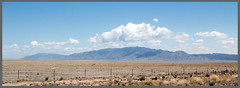 Clouds_over_the_mtn001 (jaarockin) Tags: blue light shadow mountain southwest nature yellow clouds fence desert bushes