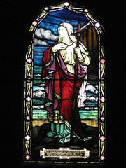 A Stained Glass Window in the St Peter the Mariner Chapel; the Mission to Seamen - Flinders Street, Melbourne (raaen99) Tags: blue red woman building green church window yellow architecture lady female club hotel inn memorial purple cross harbour interior lodging religion sailors australia melbourne chapel courtyard victoria staff historical recreation nautical 1910s shelter 20thcentury stainedglasswindow edwardian flindersstreet 30s 1917 1900s 1930 flindersst anglicanchurch welfare 1916 moh leadlight seamen placeofworship spanishmission seafarer churchwindows satinedglass twentiethcentury melbournearchitecture anglicanchapel spanishmissionstyle leadlightglass edwardiana spanishmissionarchitecture inmemorandum walterbutler missiontoseamen melbourneopenhouse hostlery architecturallydesigned openhouse2012 moh2012 melbourneopenhouse2012 missiontoseamenbuildings stpeterthemarinerchapel harbourlightsguild ladiesharbourlightsguild ethelaugustagodfrey