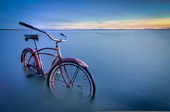 49 Schwinn (Alan Drake) Tags: ocean old blue sunset sea seascape blur colour water bike bicycle digital landscape nikon rust long exposure ghost wideangle tokina ndfilter nikonflickraward nikond7000