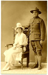 A World War I Soldier and His Wife (Alan Mays) Tags: york old men standing portraits vintage women chairs photos pennsylvania antique patterns military wwi hats couples photographers ephemera pa worldwari photographs postcards soldiers uniforms wars wives seated husbands leggings foundphotos floorcoverings studiophotos yorkcounty rppc realphotopostcards pennparkstudio