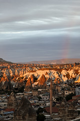 Rainbow over Goreme Valley Cappadocia (arfabita) Tags: sun color colour history nature colors lines rain weather turkey landscape interesting intense rainbow colorful colours view rooftops roman geometry vibrant circles empty patterns scenic shapes angles vivid sunny evolution scene erosion caves negative minerals era stunning limestone historical environment rays form geometrical unusual geology areas straight picturesque brilliant radiant beams arcs cloudscape spaces cappadocia clous residences goreme geological rendition sunshie archeaology