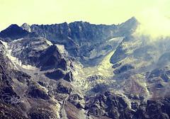 Roccia e un po' di ghiaccio (Sivi) Tags: cloud mountain mountains ice rock clouds vintage ma al rocks blu giallo cielo alta che roccia effect montagna tutti  ghiaccio adamello bello ghiacciaio effetto colorato paesello dicono comunque ritirato essersi
