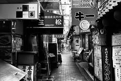 tsuruhashi, Osaka #006 (John Tayler) Tags: life street leica urban bw 35mm cityscape f14 m osaka monochrom asph summiluxm silverefexpro2 photoshopcs6