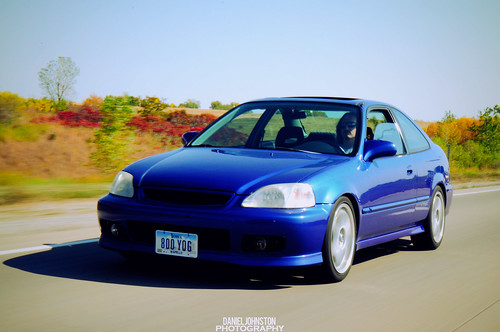 image - photo of blue Honda Civic SI driving on a country road.