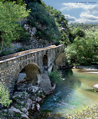 PORTITSA STONE BRIDGE II (GREECE, MACEDONIA, GREVENA, SPILEO) (KAROLOS TRIVIZAS) Tags: bridge trees mountain water river sand rocks stream stones curves arches pebbles hills greece macedonia vegetation slopes stonebridge grevena digitalcameraclub spileo blinkagain