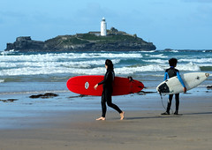 Red board (farwest56) Tags: uk blue red sea england sky people sun lighthouse man colour beach water sand women cornwall surfer sony shoreline wave surfboard seashore wetsuit godrevy gwithian stivesbay a350