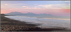 sunrise - dinas dinlle - panorama (eyeontheworld2008) Tags: pink sea seascape mountains beach wales sunrise landscape dawn surf waves pebbles timeexposure shore atmospheric gwynedd dinasdinlle