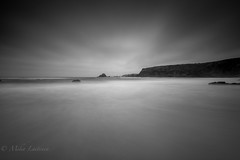 Fade in black (Mika Laitinen) Tags: atlanticocean canon7dmarkii europe portugal beach landscape nature ocean outdoor rock sea seascape shore sky summer water beja pt praia dos alteirinhos le longexposure leefilters leebigstopper cliff black white