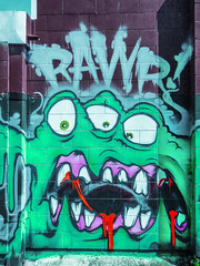 RAWR! (Steve Taylor (Photography)) Tags: triclops tryclops teeth monster alien rawr gums mku art graffiti mural streetart blue green mauve purple red white scary eerie frightening spooky mad strange odd block wall cartoon newzealand nz southisland nelson