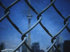 CN Tower and a fence  (Toronto). (France-) Tags: 99 fence cloture cntower toronto ontario canada picmonkey texture tourcn bokeh metal