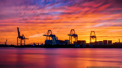 Sunset on the Delaware (mhoffman1) Tags: aurorahdr delwareriver gloucesterpark philadelphia sonyalpha southphilly a7r cloudy colorful containercranes cranes dock longexposure river shipyard sunset water gloucestercity newjersey unitedstates us