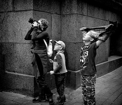 Shooting with mom (Constantin Florea) Tags: candid street outdoor streetphoto streetphotography blackwhite blackandwhite bw monochrome city urban people life capture lady woman sony children photo photograph enigmatical