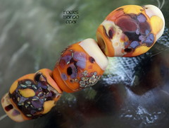 Rocks Mango Opal (Laura Blanck Openstudio) Tags: openstudio openstudiobeads handmade lampwork glass beads murano jewerlry set big rocks nuggets whimsical funky odd colorful multicolor abstract earthy organic made usa fine arts art artist artisan show published winner transparent speckles raku frit opaque matte frosted etched mango maize opal yellow coral ocher orange burnt umber eggplant lilac lavender grape purple violet sunny warm mauve sand