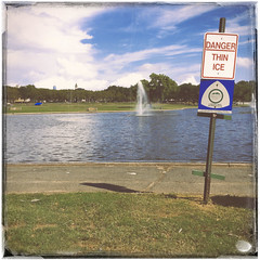 summers almost gone (JasonLee) Tags: jerseycity newjersey warningsign lincolnpark summer summer2016 sundayinthepark thinice fountain clouds lake urbanfragments faded