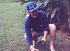 Uncle Bob Opening a Coconut with a Machete - c1983 (kimstrezz) Tags: 1983 familytriptohawaiic1983 hanaleibay kauai unclebob