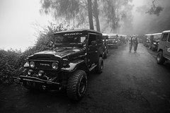Bromo, Indonesia (pas le matin) Tags: bw nb blackandwhite noiretblanc monochrome mist brouillard fog morning matin froid cold 4x4 travel voyage world bromo indonesia indonsie asia asie southeastasia road route perspective volcano volcan dof wideangle canon 7d canon7d canoneos7d