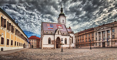 election day drama (cherryspicks (intermittently on/off)) Tags: zagreb croatia sky clouds panorama city urban church parliament government square stmarks architecture building cobblestone historic storm weather day morning flag roof tiles spire
