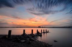 Underneath the Sunset (JJide) Tags: longexposure sunset seascape beach nature water clouds landscape sticks nikon rocks nj tokina fluid shore streaking 1116mm d7000