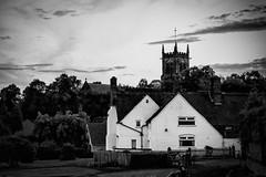 Evening, Dingle Farm and St Mary's Sandbach (ammgramm) Tags: uk trees england sky bw white black church clouds farmhouse 35mm evening blackwhite cheshire farm 17thcentury naturallight f18 stmarys squaretower sandbach d40 silverefexpro2