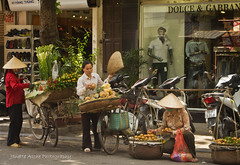 Old and the new (NettyA) Tags: street old travel people food shop modern canon women asia vietnamese traditions vietnam bicycles southeast hanoi selling scenes eos550d