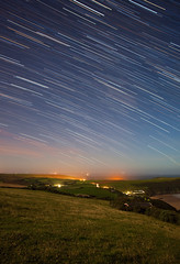 (drfugo) Tags: light sea england moon house beach grass car rock night stars star coast waves village sheep headlights devon crap hedge fields moonlight caravan croyde woolacombe startrails countyside lightstreaks saunton putsborough baggypoint pickwell sigma28mmf18exdg canon5dmkii thankstowhoeverthatwasdrivingaroundlightingupthelanes