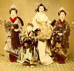 A Tayuu with two Shinzo and a Kamuro 1880s (Blue Ruin 1) Tags: japan japanese kyoto colored kimono obi tinted ojuzu juzu handcoloured shimabara meijiperiod oiran tayu tayuu meditationbeads buddhistprayerbeads shinzo kogai kamuro nenju buddhistrosary onenju thoughtbeads countingbeads femaleattendants albumenphotograph japanesecourtesan childattendant teenageattendants swordkanzashi plumblossomheaddress jiudzu