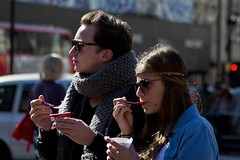 Let's have an ice-cream and think about this London (chrisjohnbeckett) Tags: street two portrait urban london sunglasses scarf bokeh candid spoon piccadillycircus explore icecream headband autumnsun londonist canonef24105mmf4lisusm chrisbeckett fotodivertenti mirroraction