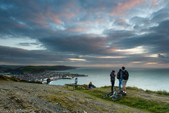 Last light on Consti (izzy's-photos) Tags: sunset sea sky people bike bicycle canon sitting cigarette watching smoking aberystwyth 24105 constitutionhill 5dmkiii blinkagain