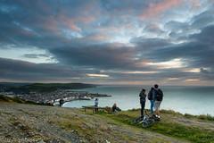 Last light on Consti (Izzy Standbridge) Tags: sunset sea sky people bike bicycle canon sitting cigarette watching smoking aberystwyth 24105 constitutionhill 5dmkiii blinkagain