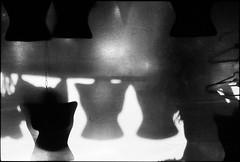 Hangers, end of the day (RoryO'Bryen) Tags: bogotá streetphotography market mercado mercadodelaspulgas roryobryen r rangefinder blackandwhite noiretblanc film scannedfromnegative scanofnegative scanned southamerica leicam6 leicam ilfordfp4 iso125 kolumbien hangers ganchos mercato urbanlifeinmetropolis analog 35mm m6 messsucher copyrightroryobryen