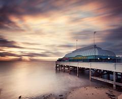 Burnham on Sea Pier (Mute*) Tags: longexposure sunset sea england beach pier seaside sand somerset flags motionblur amusements canonef1740mmf4lusm burnhamonsea bristolchannel ndfilter 10stop nd110 vertorama tenstop bwfilter110