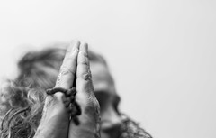 The Prayer (Catching_alchemic light) Tags: beads hair dof depthoffield perspective hands portrait face pray prayer italian song highkey bw blackwhite self up view thought thinking