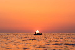 The further from the land, the closer to the sun (bettermakeanote) Tags: italy sunset boat fisherman alone d800 85mm sea summer