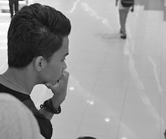 Sitting Waiting Wondering B&W (kylefrederiksen) Tags: pondering looking black white bw cool mall cebu city filipino