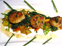 Scallops with roasted squash, spinach and potato p