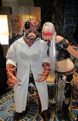 Insect monster man and leather lady - Netherworld characters (Krakitt) Tags: world costumes red woman white house black face leather monster lady bug insect costume big intense scary eyes lab dragon mask cosplay coat teeth makeup sharp spooky goop wig sweat blonde horror stare characters contact fangs creature con claws dragoncon antennae 2012 lenses netherworld pinchers nether